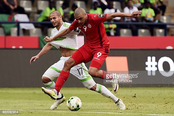 TOPSHOT Tunisia's forward Ahmed Akaichi challenges Algeria's midfielder Adlene Guedioura during the 2017 Africa Cup of Nations group B football match...