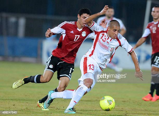 Tunisia's forward Wahbi Kharzi vies with Egyptian forward Mohamed Alniny during the 2015 Africa Cup of Nations qualifying football match between...