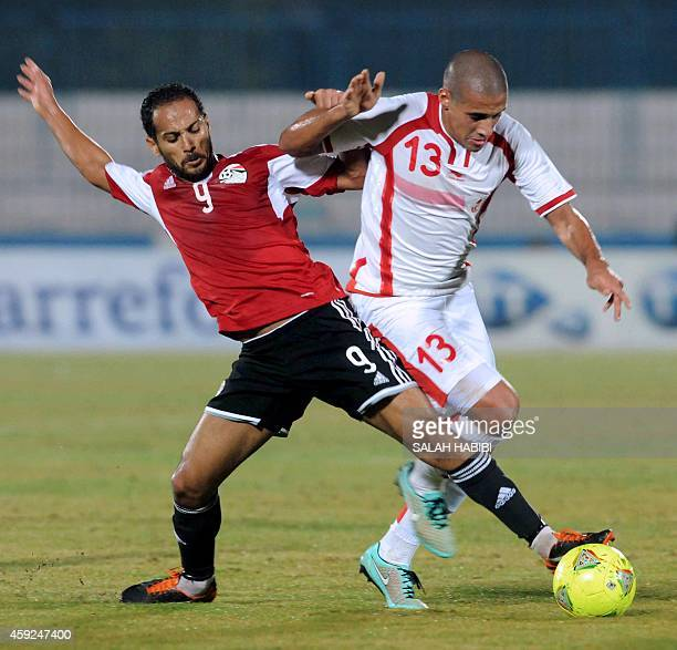 Tunisia's forward Wahbi Kharzi vies with Egyptian forward Walid Sliman during the 2015 Africa Cup of Nations qualifying football match between...