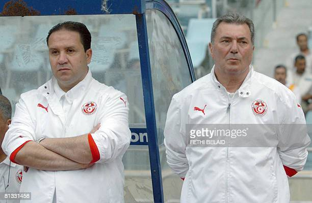 Tunisia's French coach Roger Lemerre and his assistant Tunisian Nabil Maaloul watch players during the qualifying World Cup 2010 African group 9...