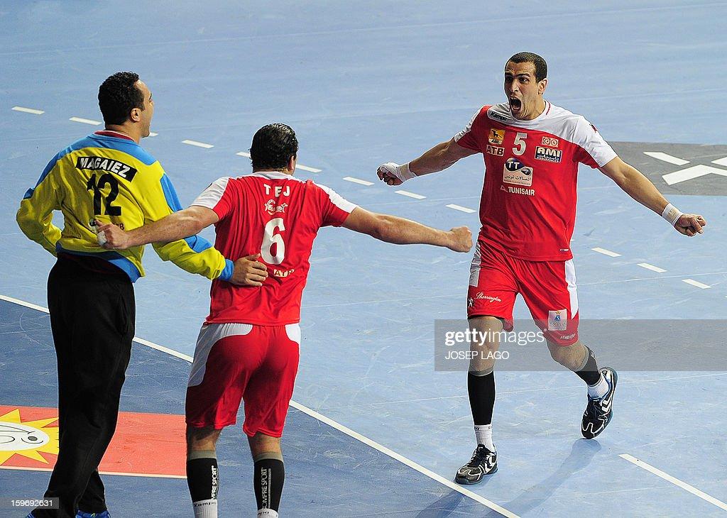Tunisia's goalkeeper Maroaune Magaiez (L), Tunisia's pivot Issam Tej (C) and Tunisia's pivot Mahmoud Gharbi (R) celebrates after winning the 23rd Men's Handball World Championships preliminary round Group A match Argentina vs Tunisia at the Palau Sant Jordi in Barcelona on January 18, 2013.