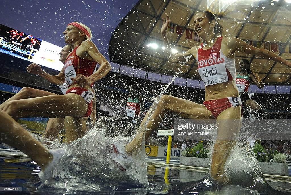 Tunisia's Habiba Ghribi (R) competes in the women's 3000m steeplechase final of the 2009 IAAF Athletics World Championships on August 17, 2009 in Berlin.