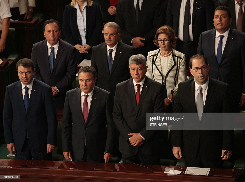 Tunisia's Interior Minister Hedi Majdoud Defence Minister Farhat Horchani Justice Minister Ghazi Jribi and premierdesignate Youssef Chahed Foreign...