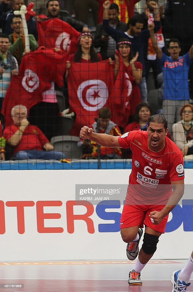 Tunisia's <a gi-track='captionPersonalityLinkClicked' href=/galleries/search?phrase=Issam+Tej&family=editorial&specificpeople=2085539 ng-click='$event.stopPropagation()'>Issam Tej</a> celebrates a goal during the 24th Men's Handball World Championships preliminary round Group B match between Austria and Tunisia at the Ali Bin Hamad Al Attiya Arena in Doha on January 19, 2015. AFP PHOTO / AL-WATAN DOHA / KARIM JAAFAR OUT ==