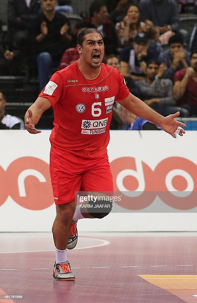 Tunisia's <a gi-track='captionPersonalityLinkClicked' href=/galleries/search?phrase=Issam+Tej&family=editorial&specificpeople=2085539 ng-click='$event.stopPropagation()'>Issam Tej</a> celebrates after scoring a goal during the 24th Men's Handball World Championships preliminary round Group B match between Austria and Tunisia at the Ali Bin Hamad Al Attiya Arena in Doha on January 19, 2015. AFP PHOTO / AL-WATAN DOHA / KARIM JAAFAR OUT ==