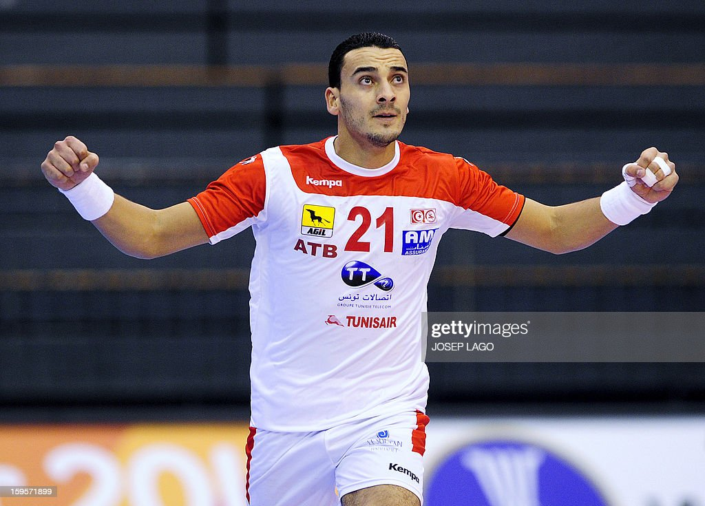 Tunisia's left wing Oussama Boughanmi celebrates after scoring during the 23rd Men's Handball World Championships preliminary round Group A match Brazil vs Tunisia at the Palacio de los Deportes de Granollers on January 16, 2013.