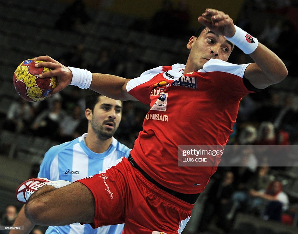 Tunisia's left wing Oussama Boughanmi shoots during the 23rd Men's Handball World Championships preliminary round Group A match Argentina vs Tunisia at the Palau Sant Jordi in Barcelona on January 18, 2013.