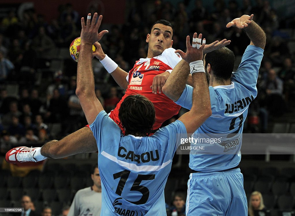 Tunisia's left wing Oussama Boughanmi (Background) shoots past Argentina's right back Leonardo Querin (R) during the 23rd Men's Handball World Championships preliminary round Group A match Argentina vs Tunisia at the Palau Sant Jordi in Barcelona on January 18, 2013. AFP PHOTO/ LLUIS GENE