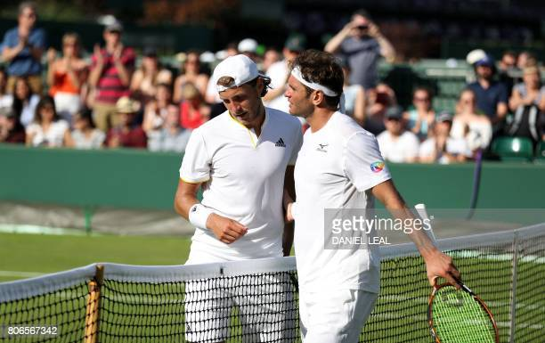Tunisia's Malek Jaziri congratulates France's Lucas Pouille on winning their men's singles first round match on the first day of the 2017 Wimbledon...
