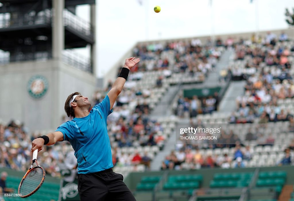 Tunisia's Malek Jaziri serves the ball to Czech Republic's Tomas Berdych during their men's second round match at the Roland Garros 2016 French Tennis Open in Paris on May 26, 2016. / AFP / Thomas SAMSON