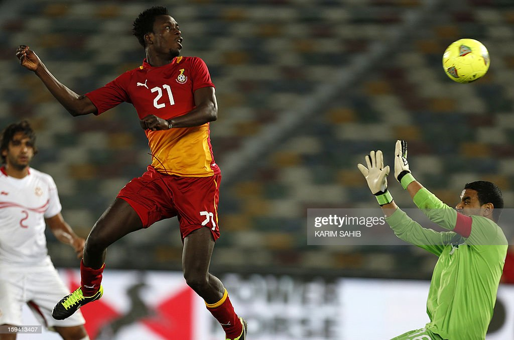 Tunisia's Mathlothi Aymen (R) heads the ball in front of Ghana's goalkeeper John Boye during their friendly football match Tunisia versus Ghana on January 13, 2013 in Abu Dhabi .