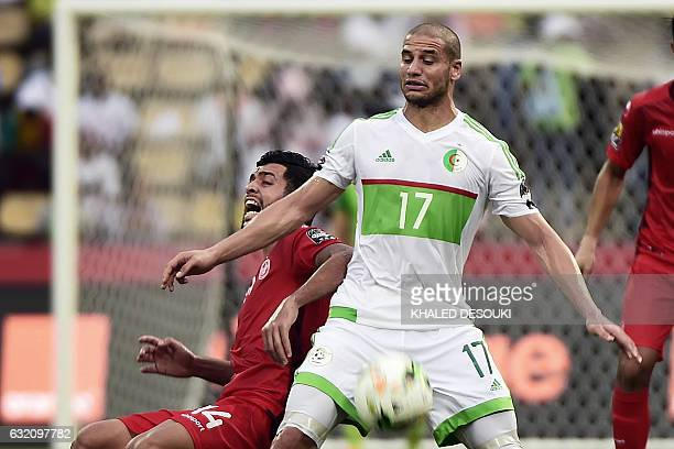 Tunisia's midfielder Mohamed Amin Ben Amor challenges Algeria's midfielder Adlene Guedioura during the 2017 Africa Cup of Nations group B football...