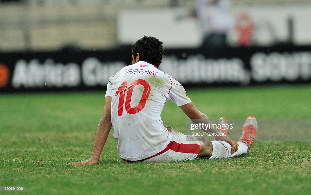 Tunisia's midfielder Oussama Darragi sits at the end of the Africa Cup of Nations 2013 group D football match Togo vs Tunisia on January 30, 2013 at the Mbombela stadium in Nelspruit. Togo drew 1-1 with Tunisia today to complete the Africa Cup of Nations quarter-final cast list and send the Carthage Eagles heading back to Tunis.