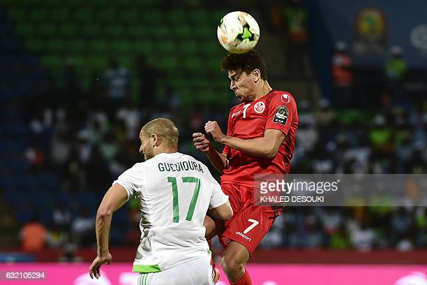 Tunisia's midfielder Youssef Msakni heads the ball next to Algeria's midfielder Adlene Guedioura during the 2017 Africa Cup of Nations group B...