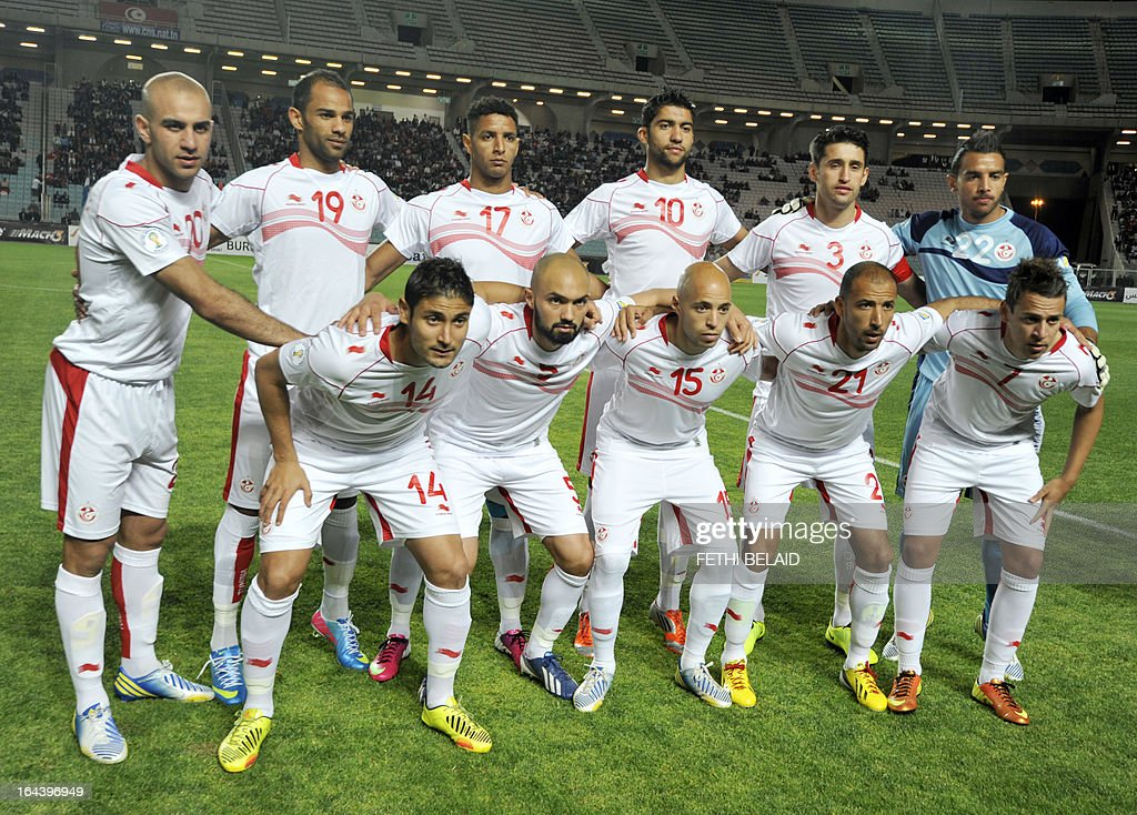 Tunisia's national football team poses before their FIFA 2014 World Cup qualifying match against Sierra Leone on March 23, 2013 at the Rades stadium in Tunis. Tunisia won 2-1.