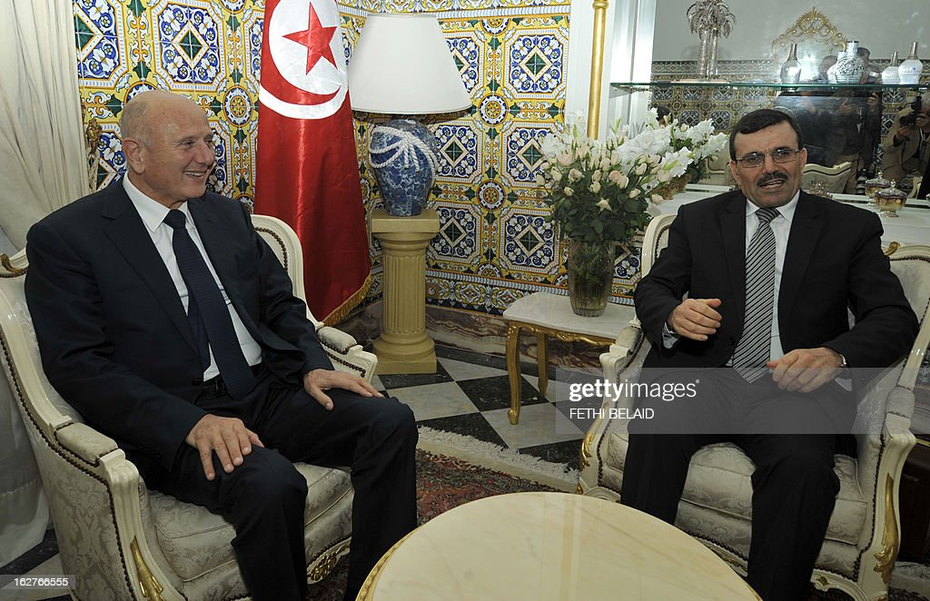 Tunisia's new Prime Minister Ali Larayedh greets Progressist Democratic Party (PDP) leader Nejib Chebbi (L), on February 26, 2013 in Tunis. On the day of Belaid's murder, then prime minister Hamadi Jebali proposed the formation of a government of technocrats as a way out of the crisis. But the initiative was rejected by his own Ennahda party, leading to his resignation. AFP PHOTO / FETHI BELAID