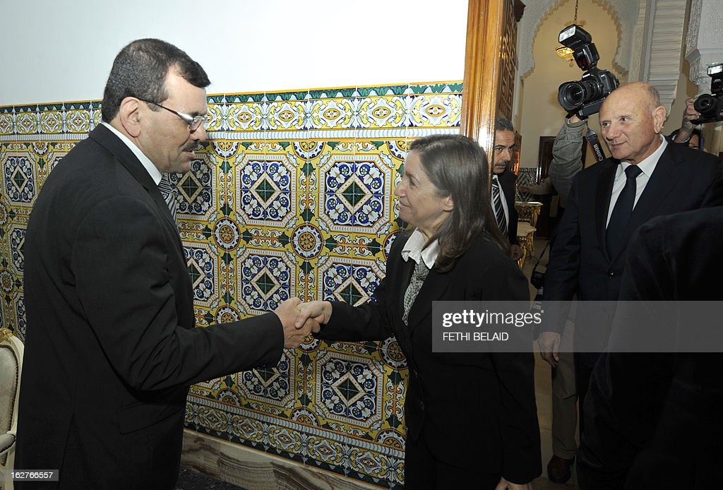 Tunisia's new Prime Minister Ali Larayedh greets Progressist Democratic Party (PDP) General Secretary Maya al-Jeribi (C) and PDP leader Nejib Chebbi (R), on February 26, 2013 in Tunis. On the day of Belaid's murder, then prime minister Hamadi Jebali proposed the formation of a government of technocrats as a way out of the crisis. But the initiative was rejected by his own Ennahda party, leading to his resignation.