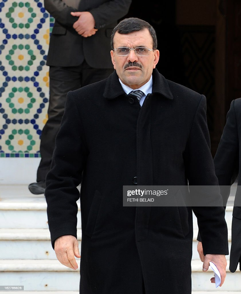 Tunisia's new Prime Minister Ali Larayedh leaves following his meeting with leaders of local political parties on February 26, 2013 in Tunis. On the day of Belaid's murder, then prime minister Hamadi Jebali proposed the formation of a government of technocrats as a way out of the crisis. But the initiative was rejected by his own Ennahda party, leading to his resignation. AFP PHOTO / FETHI BELAID