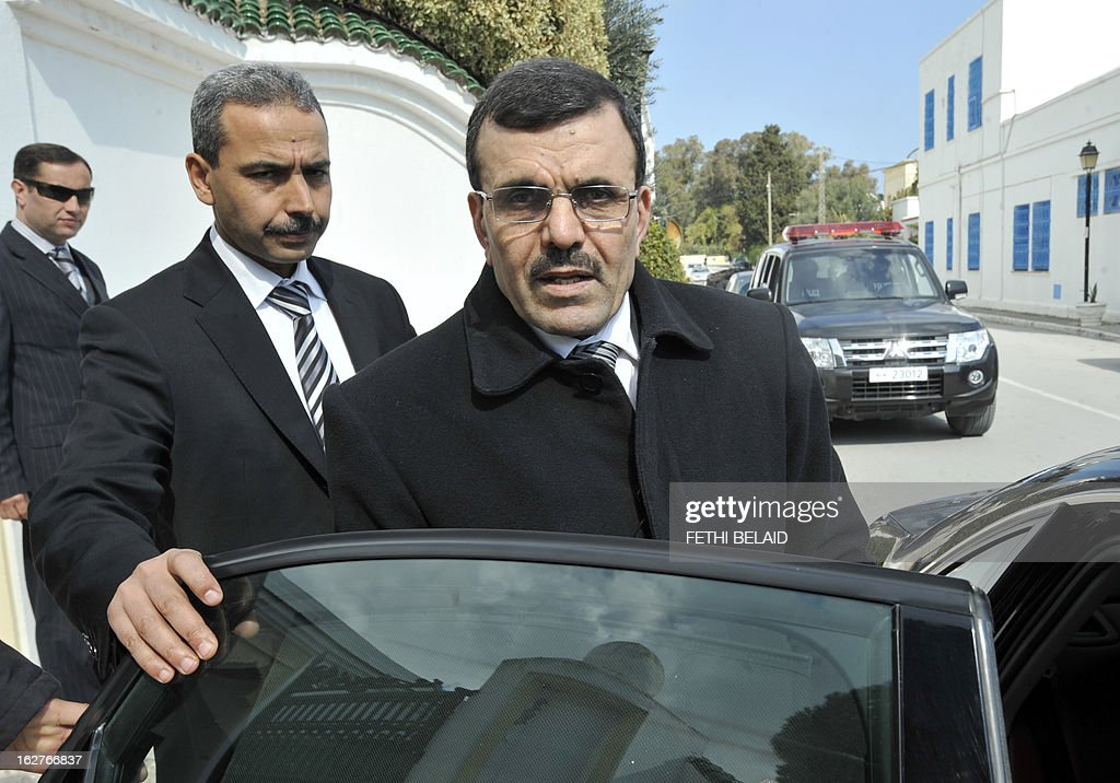 Tunisia's new Prime Minister Ali Larayedh leaves following his meeting with leaders of local political parties on February 26, 2013 in Tunis. On the day of Belaid's murder, then prime minister Hamadi Jebali proposed the formation of a government of technocrats as a way out of the crisis. But the initiative was rejected by his own Ennahda party, leading to his resignation.
