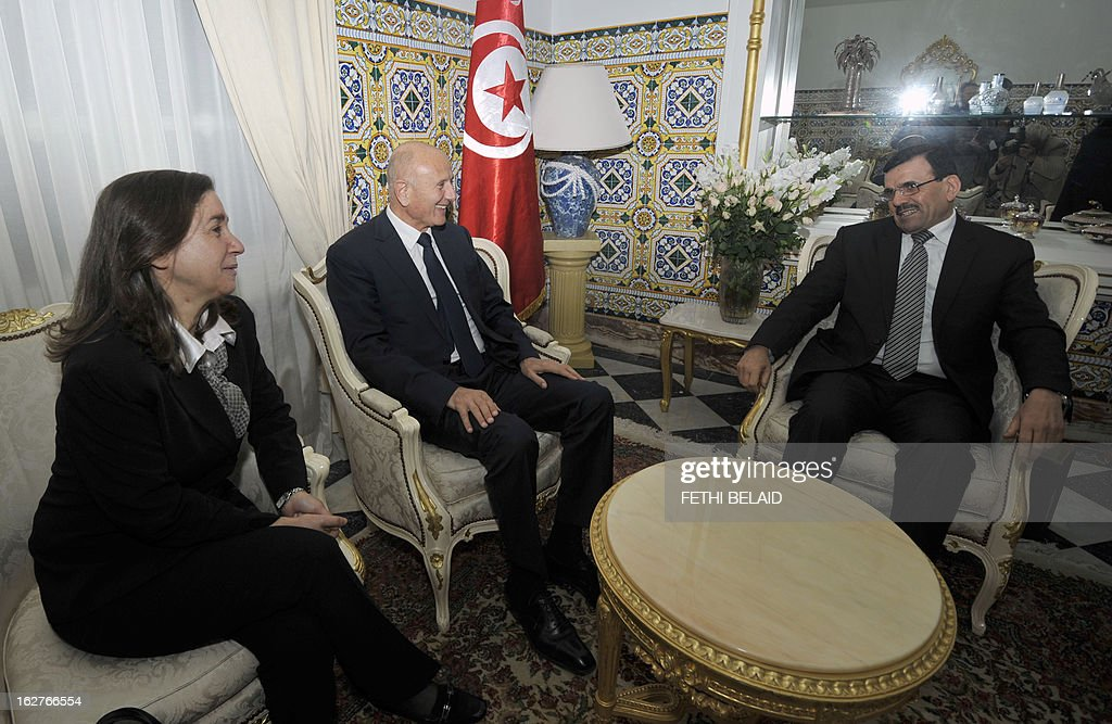 Tunisia's new Prime Minister Ali Larayedh meets with Progressist Democratic Party (PDP) General Secretary Maya al-Jeribi (L) and PDP leader Nejib Chebbi (C), on February 26, 2013 in Tunis. On the day of Belaid's murder, then prime minister Hamadi Jebali proposed the formation of a government of technocrats as a way out of the crisis. But the initiative was rejected by his own Ennahda party, leading to his resignation.