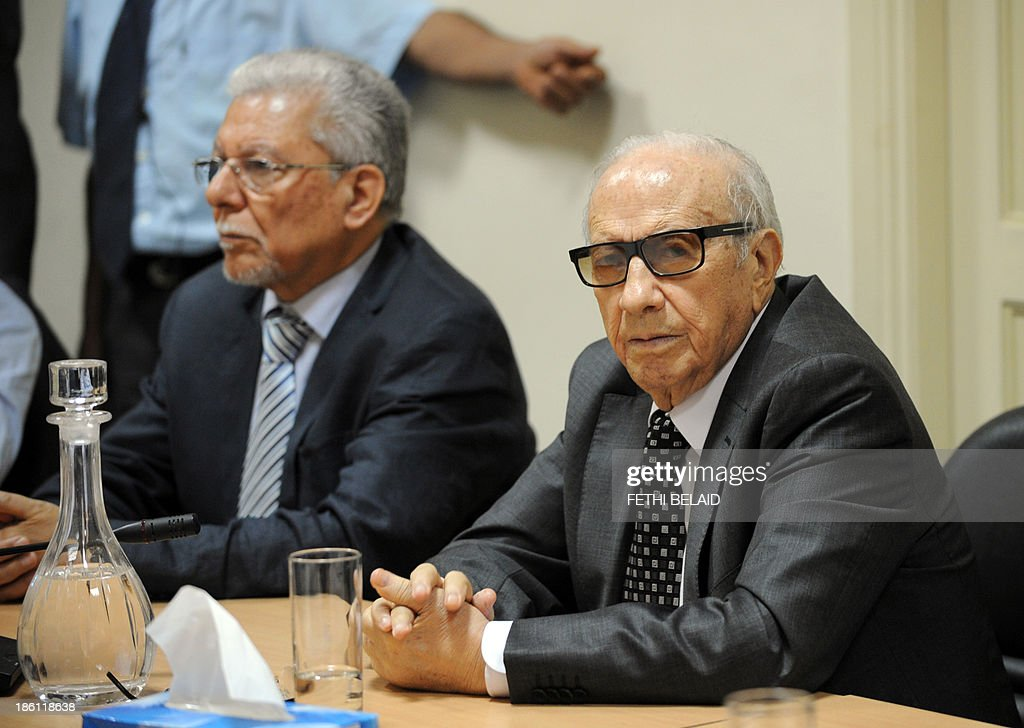 Tunisia's Nidaa Tounes party founder, and President, Beji Caid Essebsi (R), attends a meeting as part of the dialogue between the ruling Islamists and the opposition aimed at ending a two-month political crisis on October 28, 2013 in Tunis. Ennahda and the opposition signed a roadmap for the creation of a government of independents within three weeks. Tunisia was plunged into crisis in July when opposition politician Mohamed Brahmi was shot dead by suspected jihadist gunmen in circumstances similar to the murder of another opposition MP, Chokri Belaid, six months earlier.
