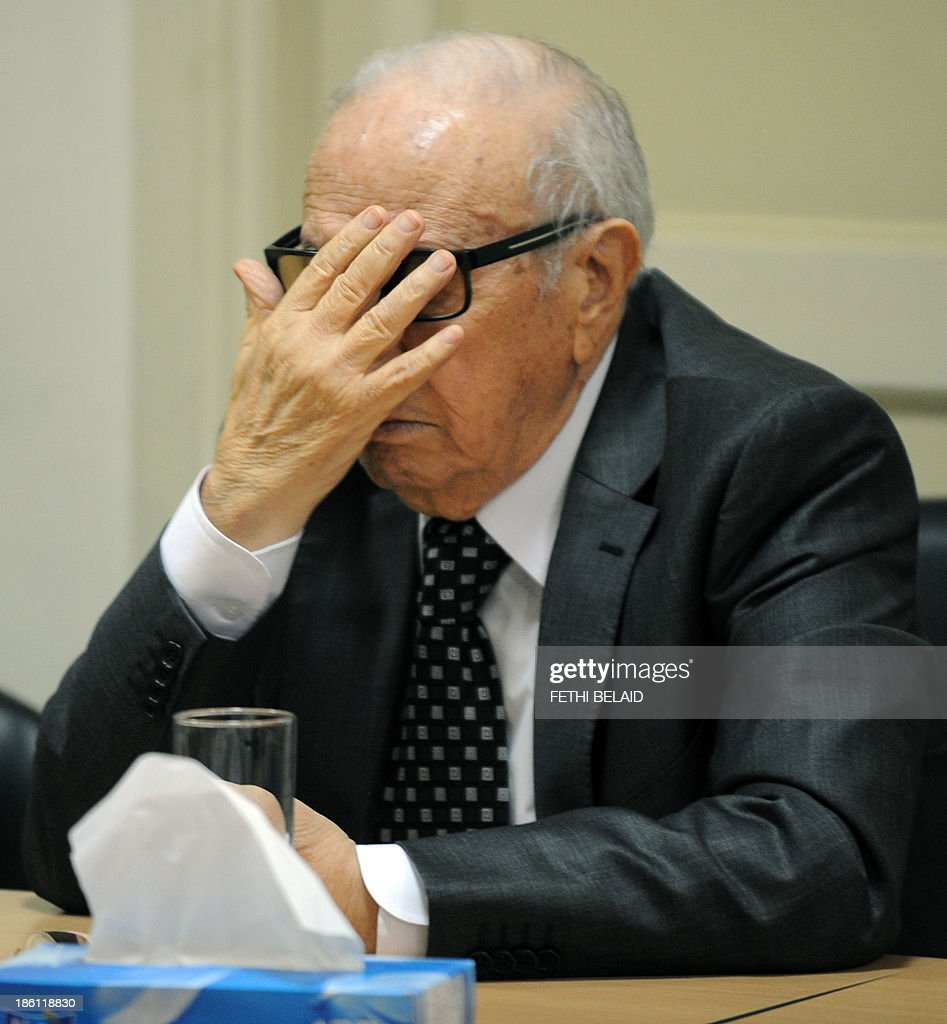 Tunisia's Nidaa Tounes party founder, and President, Beji Caid Essebsi, adjusts his glasses as he attends a meeting as part of the dialogue between the ruling Islamists and the opposition aimed at ending a two-month political crisis on October 28, 2013 in Tunis. Ennahda and the opposition signed a roadmap for the creation of a government of independents within three weeks. Tunisia was plunged into crisis in July when opposition politician Mohamed Brahmi was shot dead by suspected jihadist gunmen in circumstances similar to the murder of another opposition MP, Chokri Belaid, six months earlier.