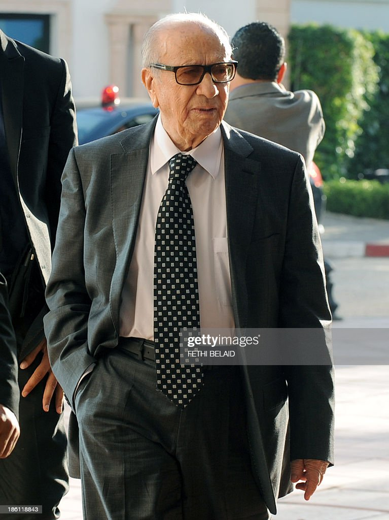Tunisia's Nidaa Tounes party founder, and President, Beji Caid Essebsi, arrives to attend a meeting as part of the dialogue between the ruling Islamists and the opposition aimed at ending a two-month political crisis on October 28, 2013 in Tunis. Ennahda and the opposition signed a roadmap for the creation of a government of independents within three weeks. Tunisia was plunged into crisis in July when opposition politician Mohamed Brahmi was shot dead by suspected jihadist gunmen in circumstances similar to the murder of another opposition MP, Chokri Belaid, six months earlier.