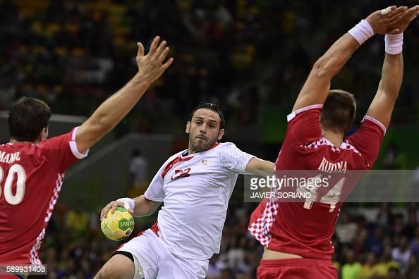 TOPSHOT Tunisia's pivot Sobhi Saied vies with Croatia's pivot Kresimir Kozina during the men's preliminaries Group A handball match Croatia vs...
