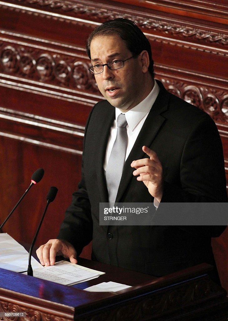 Tunisia's premierdesignate Youssef Chahed delivers a speech during a parliamentary session in Tunis on August 26 to vote on a cabinet lineup proposed...