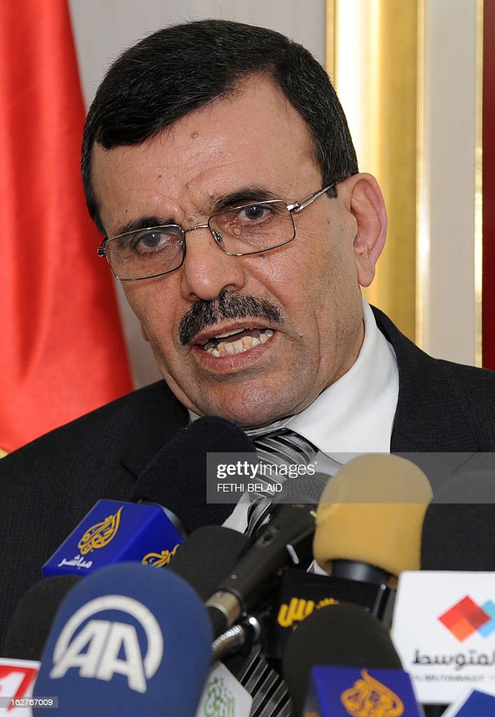 Tunisia's prime minister-designate Ali Larayedh speaks during a press conference on February 26, 2013 in Tunis. Radical Salafist Muslims murdered Tunisian opposition leader Chokri Belaid, with four suspects arrested and the killer identified but still on the run, Interior Minister Ali Larayedh.