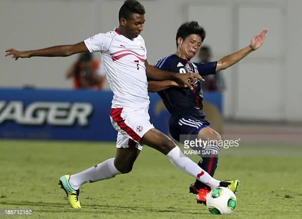 Tunisia's Rached Ardaoui vies with Japan's Daisuke Sakai during the FIFA U17 World Cup UAE 2013 football match Tunis versus Japan on October 24 2013...