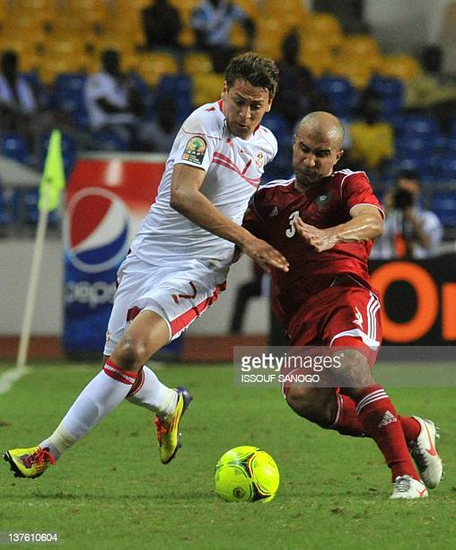 Tunisia's striker Youssef Msakni vies with Morocco's defender Badr El Kaddouri during the Africa Cup of Nations 2012 Group C football match between...