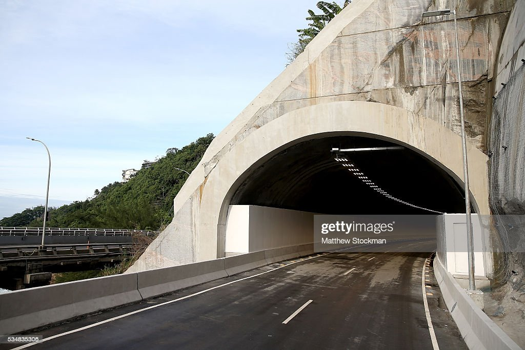 Tunnel Engineer Luiz Jacques de Moraes and Presidient Itamar Franco High Road, delivered earlier in the day by Rio de Janeiro Mayor Eduardo Paes as part of new infrastructure to connect the south zone with Barra da Tijuca on May 28, 2016 in Rio de Janeiro, Brazil.
