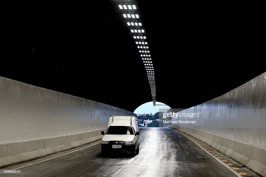 Tunnel Engineer Paulo Cezar Marcelino Figueire and Presidient Itamar Franco High Road, delivered earlier in the day by Rio de Janeiro Mayor Eduardo Paes as part of new infrastructure to connect the south zone with Barra da Tijuca on May 28, 2016 in Rio de Janeiro, Brazil.