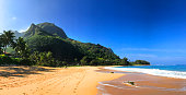 Tunnels Beach with its yellow sand and jungle mountains in Kauai Hawaii