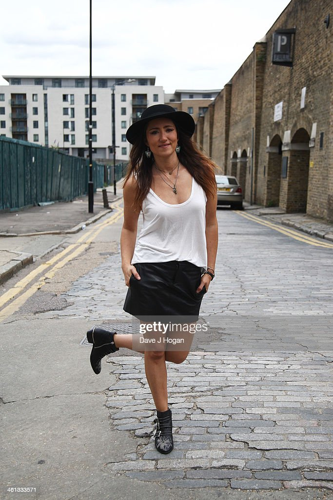 <a gi-track='captionPersonalityLinkClicked' href=/galleries/search?phrase=KT+Tunstall&family=editorial&specificpeople=216375 ng-click='$event.stopPropagation()'>KT Tunstall</a> performs for a biz session on August 13, 2013 in London, England.