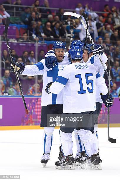 Tuomo Ruutu of Finland celebrates with his teammates after scoring a goal in the second period against Carey Price of Canada during the Men's Ice...