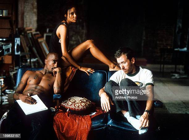 Tupac Shakur Thandie Newton and Tim Roth hang out in an apartment in a scene from the film 'Gridlock'd' 1997