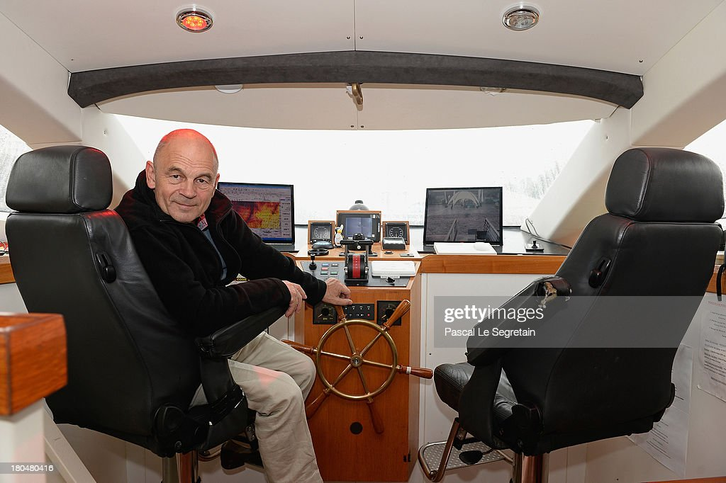 Turanor PlanetSolar's Captain Gerard D'Aboville poses in the cockpit of the largest solar vessel in the world powered exclusively by the sun on September 13, 2013 in Paris, France. After five months in the Gulf Stream using data gathered from it's journey, 'to examine how oceanic processes interact with the atmosphere', the record breaking vessel has docked in the River Seine in Paris.