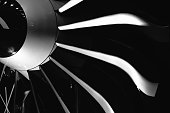 Close-up of a turbofan jet engine in modern airplane. Monochrome