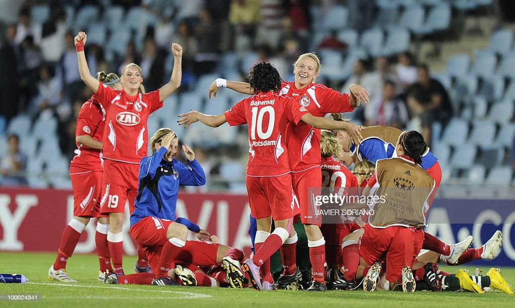 FFC Turbine Potsdam's football players celebrate after wining their UEFA women's Final Champions League football match against Olympique Lyonnais at Coliseum Alfonso Pérez on May 20, 2010 in Getafe. Potsdam won 7-6 after the penalty session following a 0-0 draw.