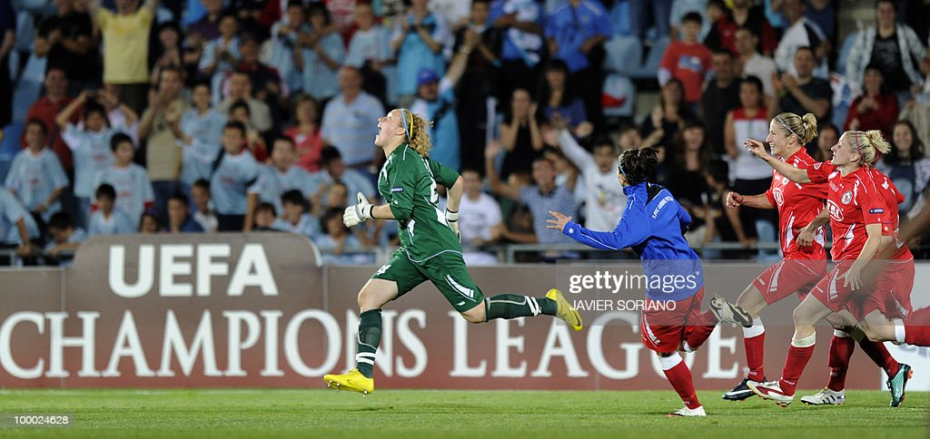 FFC Turbine Potsdam's goalkeeper Anna Felicitas Sarholz (L) runs as she celebrates witht teammates after wining their UEFA women's Final Champions League football match against Olympique Lyonnais at Coliseum Alfonso Pérez on May 20, 2010 in Getafe. Potsdam won 7-6 after the penalty session following a 0-0 draw.