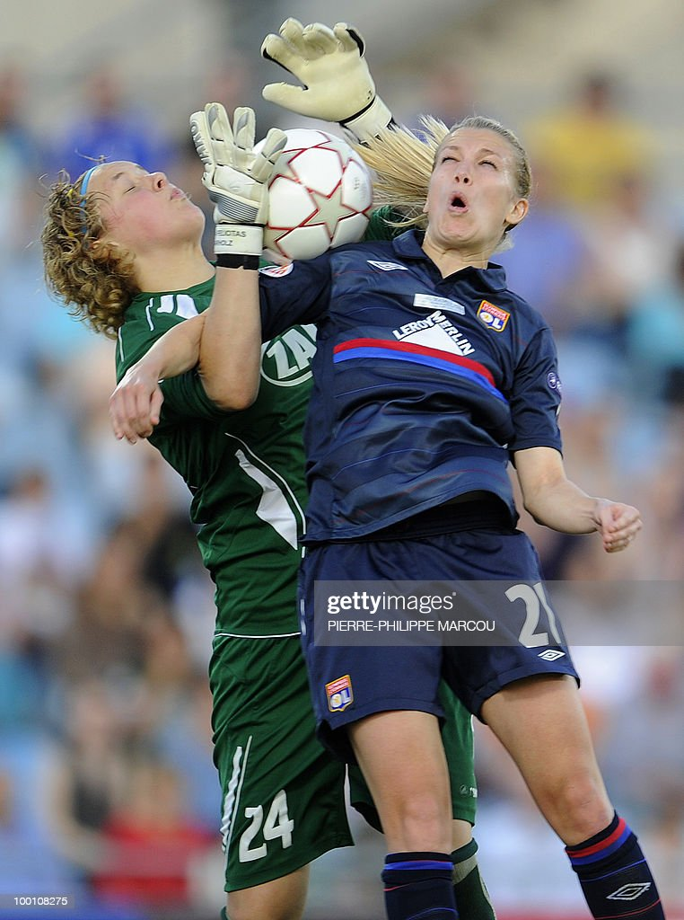 FFC Turbine Potsdam's goalkeeper Anna Felicitas Sarholz (L) vies with Olympique Lyonnais' Swiss midfielder Lara Dickenmann during their Final women's Champions League football match at Coliseum Alfonso Pérez on May 20, 2010 in Getafe.
