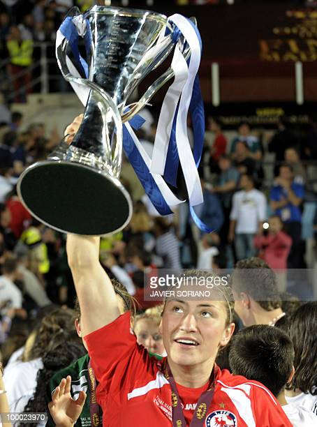 FFC Turbine Potsdam's midfielder Jennifer Zietz holds up the trophy after wining their UEFA women's Final Champions League football match against...