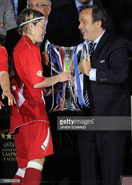 FFC Turbine Potsdam's midfielder Jennifer Zietz receives the trophy from UEFA President Michel Platini after wining their UEFA women's Final...