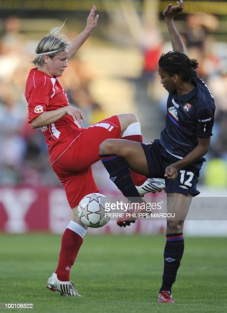 FFC Turbine Potsdam's midfielder Jennifer Zietz vies with Olympique Lyonnais' forward Élodie Thomis during their Final women's Champions League...