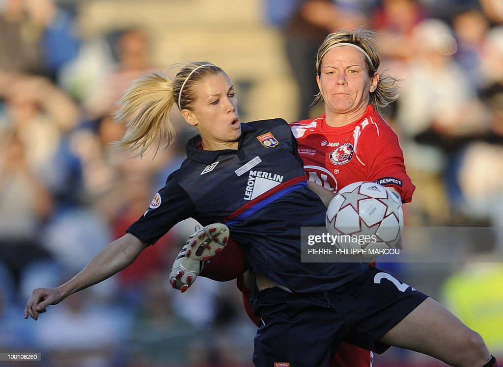 FFC Turbine Potsdam's midfielder Jennifer Zietz (R) vies with Olympique Lyonnais' Swiss midfielder Lara Dickenmann during their Final women's Champions League football match at Coliseum Alfonso Pérez on May 20, 2010 in Getafe.