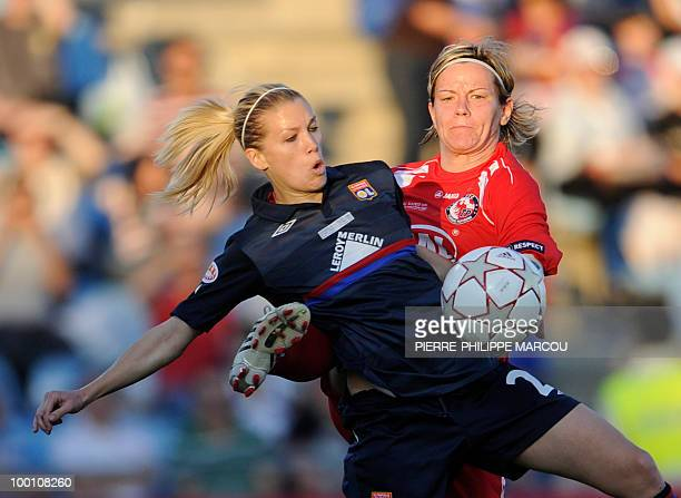 FFC Turbine Potsdam's midfielder Jennifer Zietz vies with Olympique Lyonnais' Swiss midfielder Lara Dickenmann during their Final women's Champions...