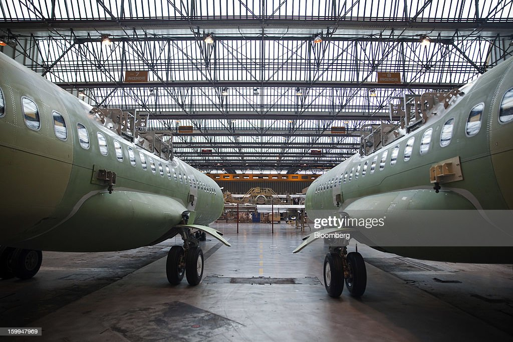 ATR 72 turboprop aircraft, manufactured by Avions de Transport Regional (ATR), stand at the company's production facility in Colomiers, France, on Wednesday, Jan. 23, 2013. ATR, the world's largest maker of turbo-propeller airliners, reported record profit for 2012, even as it fell short of its shipment target amid production delays. Photographer: Balint Porneczi/Bloomberg via Getty Images