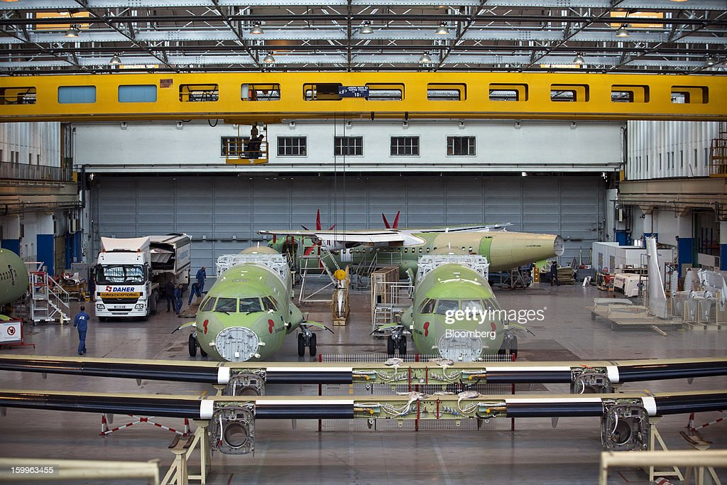 ATR-72 turboprop aircraft, manufactured by Avions de Transport Regional (ATR), stand during assembly at the company's production facility in Colomiers, France, on Wednesday, Jan. 23, 2013. ATR, the world's largest maker of turbo-propeller airliners, reported record profit for 2012, even as it fell short of its shipment target amid production delays. Photographer: Balint Porneczi/Bloomberg via Getty Images